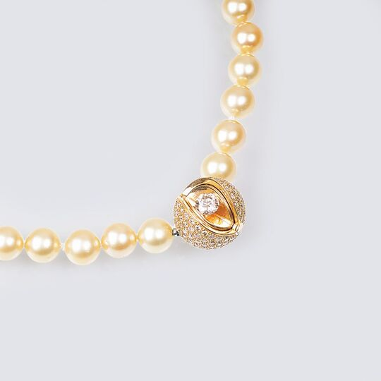 A Highcarat Solitaire Diamond Mystery Sphere Clasp on Pearl Necklace