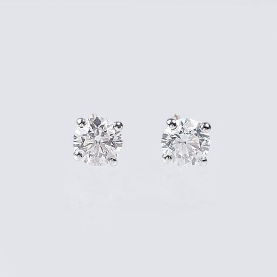 A Pair of Rare-White Solitaire Diamond Earrings