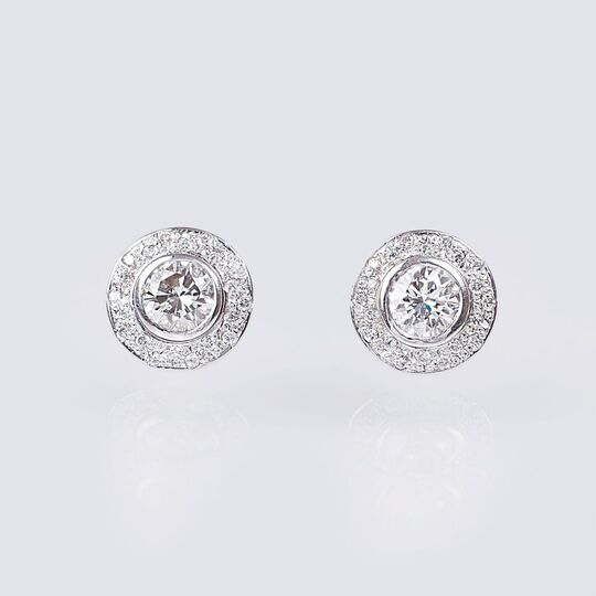 A Pair of Solitaire Diamond Earstuds with Diamonds