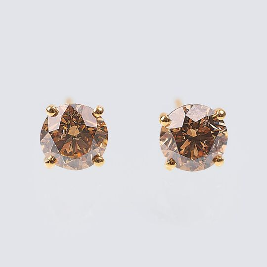 A Pair of Fancy Diamond Solitaire Earrings